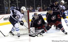 Winnipeg Jets' Jason Jaffray skates around Columbus net in first-period action Tuesday.