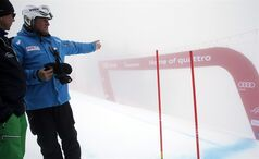FIS referee Gunther Hujara from Germany gestures on the course of the men's downhill of the Alpine skiing World Cup finals in Lenzerheide, Switzerland, Wednesday, March 13, 2013. The Jury had to cancel the men's downhill due to the heavy fog. (AP Photo/Shinichiro Tanaka)