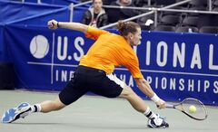 Alex Bogomolov Jr., of Russia, hits a return to Kei Nishikori of Japan, during a quarterfinal match at the U.S. National Indoor Tennis Championships on Friday, Feb. 14, 2014, in Memphis, Tenn. (AP Photo/Rogelio V. Solis)