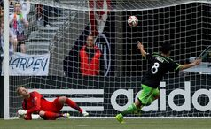 Vancouver Whitecaps' goalkeeper David Ousted, left, of Denmark, reacts as Seattle Sounders' Gonzalo Pineda, of Mexico, celebrates his penalty kick goal during the second half of an MLS soccer game in Vancouver, B.C., on Saturday May 24, 2014. THE CANADIAN PRESS/Darryl Dyck