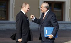 Secretary-General of the Organisation for Economic Co-Operation and Development Jose Angel-Gurria, right, gestures while speaking with Russia's President Vladimir Putin during arrivals for the G-20 summit at the Konstantin Palace in St. Petersburg, Russia on Thursday, Sept. 5, 2013. The threat of missiles over the Mediterranean is weighing on world leaders meeting on the shores of the Baltic this week, and eclipsing economic battles that usually dominate when the G-20 world economies meet. (AP Photo/Alexander Zemlianichenko)