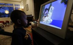 EMBARGOED UNTIL MIDNIGHT EASTERN TIME SUNDAY, FEB. 17 - Joe Jensen, 2, watches television as a special treat in the afternoon, Tuesday, Feb. 12, 2013 at his home in Seattle. Joe's mother, Nancy Jensen, was a participant in a new University of Washington study on the effects of television viewing on kids that will be published Monday, Feb. 18, 2013. (AP Photo/Ted S. Warren)