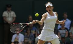 Simona Halep of Romania plays a return to Sabine Lisicki of Germany dduring their women's singles quarterfinal match at the All England Lawn Tennis Championships in Wimbledon, London, Wednesday, July 2, 2014. (AP Photo/Pavel Golovkin)
