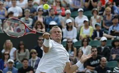 Lleyton Hewitt of Australia plays a return to Jerzy Janowicz of Poland during their men's singles match at the All England Lawn Tennis Championships in Wimbledon, London, Friday, June 27, 2014. (AP Photo/Ben Curtis)