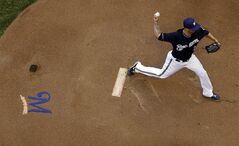 Milwaukee Brewers starting pitcher Kyle Lohse throws during the first inning of a baseball game against the Colorado Rockies on Friday, June 27, 2014, in Milwaukee. (AP Photo/Morry Gash)