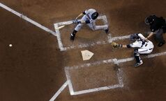 Minnesota Twins' Joe Mauer hits a double during the fourth inning of an interleague baseball game against the Milwaukee Brewers, Monday, June 2, 2014, in Milwaukee. (AP Photo/Morry Gash)