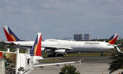 Philippine Airlines passenger planes are parked at the carrier's terminal at the Manila International Airport April 12, 2012, in Pasay city, south of Manila, Philippines. THE CANADIAN PRESS/AP, Bullit Marquez