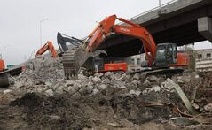 Demolition continues on the old Disraeli Freeway span as seen from Sutherland Ave. On Friday, officials opened the new freeway in rear that took over three years to build.