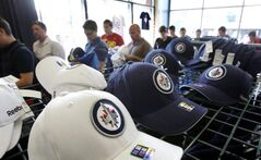 Winnipeg Jets fans line up in the  team store 'Jets Gear' in the MTS Centre to purchase Winnipeg Jets hats, T-shirts, and kids wear with the new team logo Friday.