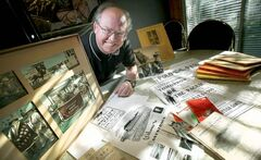Assiniboia Downs' historian Bob Gates at home with some of his large collection of track memorabilia. Gates has been a racing fan since he can remember.