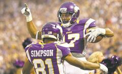 Vikings wide receiver Jarius Wright celebrates a touchdown with Jerome Simpson Nov. 11.