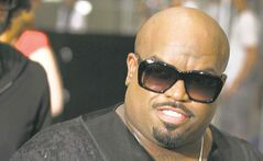 American rapper Cee Lo Green arrives at the Marina Bay Sands on Thursday, May 23, 2013 in Singapore for the inaugural Social Star Awards.(AP Photo/Wong Maye-E)