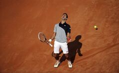 Serbia's Novak Djokovic shouts in celebration after winning a point during his semifinal match against Canada's Milos Raonic at the Italian open tennis tournament in Rome, Saturday, May 17, 2014. (AP Photo/Gregorio Borgia)