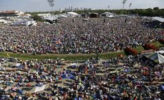 The skyline of New Orleans is seen as crowds watch Bruce Springsteen perform at the New Orleans Jazz and Heritage Festival in New Orleans, Saturday, May 3, 2014. (AP Photo/Gerald Herbert)