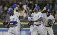 Kansas City Royals' Jarrod Dyson, from left, Eric Hosmer, Lorenzo Cain and Alcides Escobar celebrate their 11-4 over the Detroit Tigers in a baseball game in Detroit, Tuesday, June 17, 2014. (AP Photo/Paul Sancya)