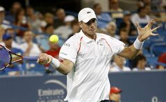 John Isner, from the United States, returns a volley to Kevin Anderson, from South Africa, in a first round match at the Western & Southern Open tennis tournament, Monday, Aug. 11, 2014, in Mason, Ohio. Isner won 6-3, 6-4. (AP Photo/David Kohl)