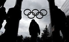 The Olympic rings hang above travelers leaving the central train station, Wednesday, Jan. 29, 2014, in Sochi, Russia, home of the upcoming 2014 Winter Olympics. (AP Photo/David Goldman)