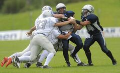 Villanova College's Alexander Montini can't break through the Raiders' defence.
