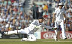England's Jos Buttler hits the wicket to run out India's Varun Aaron during the third day of the fifth test cricket match at Oval cricket ground in London, Sunday, Aug. 17, 2014. (AP Photo/Alastair Grant)