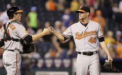 Baltimore Orioles relief pitcher Troy Patton (right) is pictured July 22, 2013, in Kansas City, Mo. THE CANADIAN PRESS/AP, Charlie Riedel