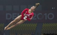Canada's Gabby May performs on the vault during team gymnastics at the Commonwealth Games in New Delhi October 5, 2010.