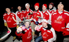 Canadian team members Colin Phaneuf and Jono Brett (front from left) display the bandy balls used in competition.