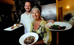 Chef Scott Bagshaw poses with Resto Gare owner Linda Love and three dishes, left to right: maple syrup pie, escargot and beef bourguignon.