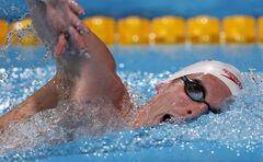 Canada's Ryan Cochrane swims in a men's 1500-metre freestyle heat at the FINA Swimming World Championships in Barcelona, Spain, Saturday, Aug. 3, 2013. Cochrane says spending time in the classroom has helped him better understand what he should be doing in the pool. THE CANADIAN PRESS/AP Photo/Michael Sohn