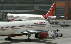 Air India planes are parked on the tarmac at Indira Gandhi International Airport in New Delhi, India, on May 18, 2012. Aeroplan says its members can now start earning and redeeming points for travel with Air India. THE CANADIAN PRESS/AP, Kevin Frayer