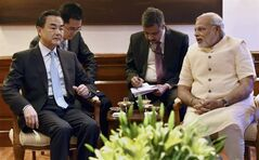 Visiting Chinese Foreign Minister Wang Yi, left, sits with Indian Prime Minister Narendra Modi, right during their meeting in New Delhi, India, Monday, June 9, 2014. (AP Photo)