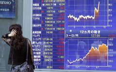 A woman looks at an electronic stock board of a securities firm in Tokyo, Thursday, June 27, 2013. Stock markets from Sydney to Shanghai extended gains for a second day Thursday after the U.S. said quarterly growth may be weaker than expected, raising investors' hopes that the Federal Reserve would delay plans to wind down its stimulus program. (AP Photo/Koji Sasahara)