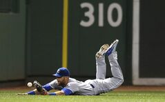 Kansas City Royals left fielder Alex Gordon dives but can't make the play on a single by Boston Red Sox's Daniel Nava during the sixth inning of a baseball game at Fenway Park in Boston, Friday, July 18, 2014. (AP Photo/Charles Krupa)