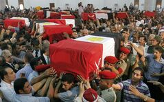 A sign of Egypt's deep dysfunction — bodies of Egyptian soldiers killed by extremists Sunday are carried to a funeral in Cairo Tuesday.