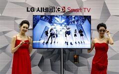 FILE - In this Thursday, Jan. 19, 2012, file photo, South Korean models pose with a CINEMA 3D Smart TV during a press conference to introduce the LG Electronics' television and the company's marketing strategy for 2012 in Seoul, South Korea. Hewlett-Packard said Monday, Feb. 25, 2013, it is selling its webOS operating system technology to South Korea's LG Electronics Inc. for an undisclosed sum. Hewlett Packard Co. and LG said on Monday that LG will use webOS to support its