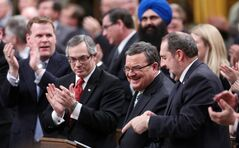 Minister of Finance Jim Flaherty is applauded as he arrives to table the budget in the House of Commons on Parliament Hill in Ottawa on Tuesday, February 11, 2014. THE CANADIAN PRESS/Fred Chartrand