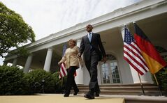 President Barack Obama and German Chancellor Angela Merkel arrive for their joint news conference in the Rose Garden of the White House in Washington, Friday, May 2, 2014. Obama and Merkel are putting on a display of trans-Atlantic unity against an assertive Russia, even as sanctions imposed by Western allies seem to be doing little to change Russian President Vladimir Putin's reasoning on Ukraine. (AP Photo/Charles Dharapak)