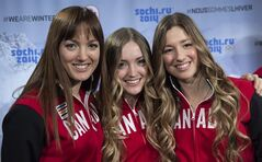 Sisters Maxime, Chloe and Justine Dufour-Lapointe, left to right, smile after being introduced as members of Canada's Olympic freestyle skiing team, Monday, January 20, 2014 in Montreal. THE CANADIAN PRESS/Paul Chiasson