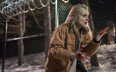"This image released by Netflix shows Taylor Schilling in a scene from ""Orange is the New Black."" The second season of the prison series is now on Netflix. THE CANADIAN PRESS/AP-ho-Netflix-JoJo Whilden"