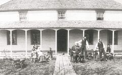 Robert McBeth Sr. and family in front of the 1850s McBeth house from 1885.