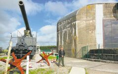 Clement Davies stands next to the railway gun and bunker the Germans built on his father's farm. Batterie Todt, as it was known, was erected to attack shipping in the English Channel, but some of its shells fell on English soil, too.