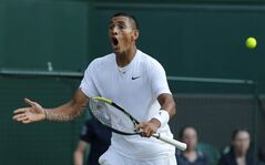 Nick Kyrgios of Australia shouts out as he plays against Rafael Nadal of Spain during their men's singles match on Centre Court at the All England Lawn Tennis Championships in Wimbledon, London, Tuesday, July 1, 2014. (AP Photo/Ben Curtis)