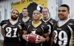 University of Manitoba Bisons football players Teague Sherman (from left), Pete Adams, Anthony Coombs, Thomas Hall and Nic Demski were named Canada West conference all-stars in 2011. Coombs, Demski and Sherman have made the list again this year.