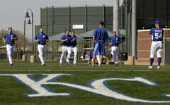 Kansas City Royals catchers run during morning workouts at spring training baseball practice, Saturday, Feb. 15, 2014, in Surprise, Ariz. (AP Photo/Tony Gutierrez)