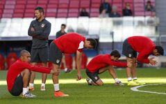 Atletico's coach Diego Simeone background left looks on, during a training session ahead of Saturday's Champions League final soccer match between Real Madrid and Atletico Madrid, in Luz stadium in Lisbon, Portugal, Friday, May 23, 2014. (AP Photo/Daniel Ochoa de Olza)