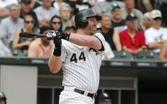 Chicago White Sox's Adam Dunn watches his three-run home run off San Francisco Giants starting pitcher Tim Hudson during the fifth inning of an interleague baseball game Wednesday, June 18, 2014, in Chicago. The White Sox's Jose Abreu and Conor Gillaspies scored on the hit. (AP Photo/Charles Rex Arbogast)