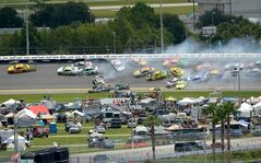 Joey Logano leads a multi-car accident in Turn 3 during a NASCAR Sprint Cup Series auto race at the Daytona International Speedway in Daytona Beach, Fla., Sunday, July 6, 2014. (AP Photo/Phelan M. Ebenhack)