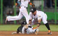 Pittsburgh Pirates left fielder Starling Marte, left, steals second base as Miami Marlins second baseman Rafael Furcal, right, unable to tag in the third inning of a baseball game on Friday, June 13, 2014, at Marlins Park in Miami. (AP Photo/El Nuevo Herald, David Santiago)