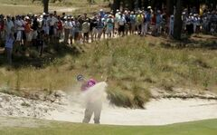 Justin Thomas hits out of a bunker on the 16th hole during a practice round for the U.S. Open golf tournament in Pinehurst, N.C., Tuesday, June 10, 2014. The tournament starts Thursday. (AP Photo/Charles Riedel)