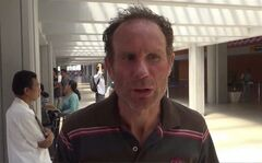 In this image taken from video, Tony Lawton of New Zealand, a survivor from a boat sinking, speaks to the media at an airport in Bali, Indonesia Monday, Aug. 18, 2014. Rescuers on Monday safely recovered 13 more people from a tourist boat that sank after hitting a reef in central Indonesia, but were searching for a Dutch man and an Italian woman who were still missing, officials said. (AP Photo/AP Video)