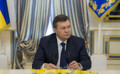 Ukrainian President Viktor Yanukovych attends the signing of an agreement to end the crisis.
